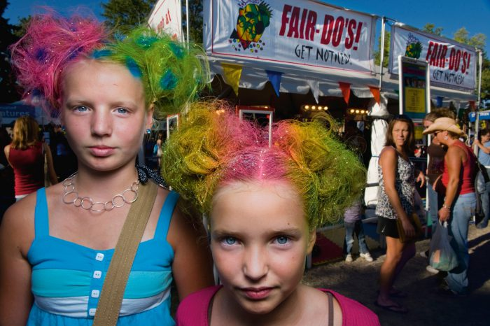Photo: Sisters with rainbow colored hairstyles with glitter at the Minnesota state fair.