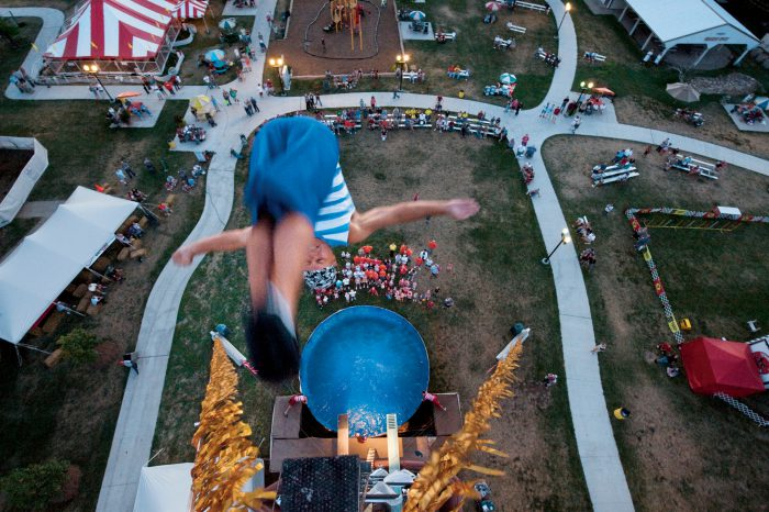 Photo: Atop the 80-foot tower during a high dive act at the Nebraska state fair.