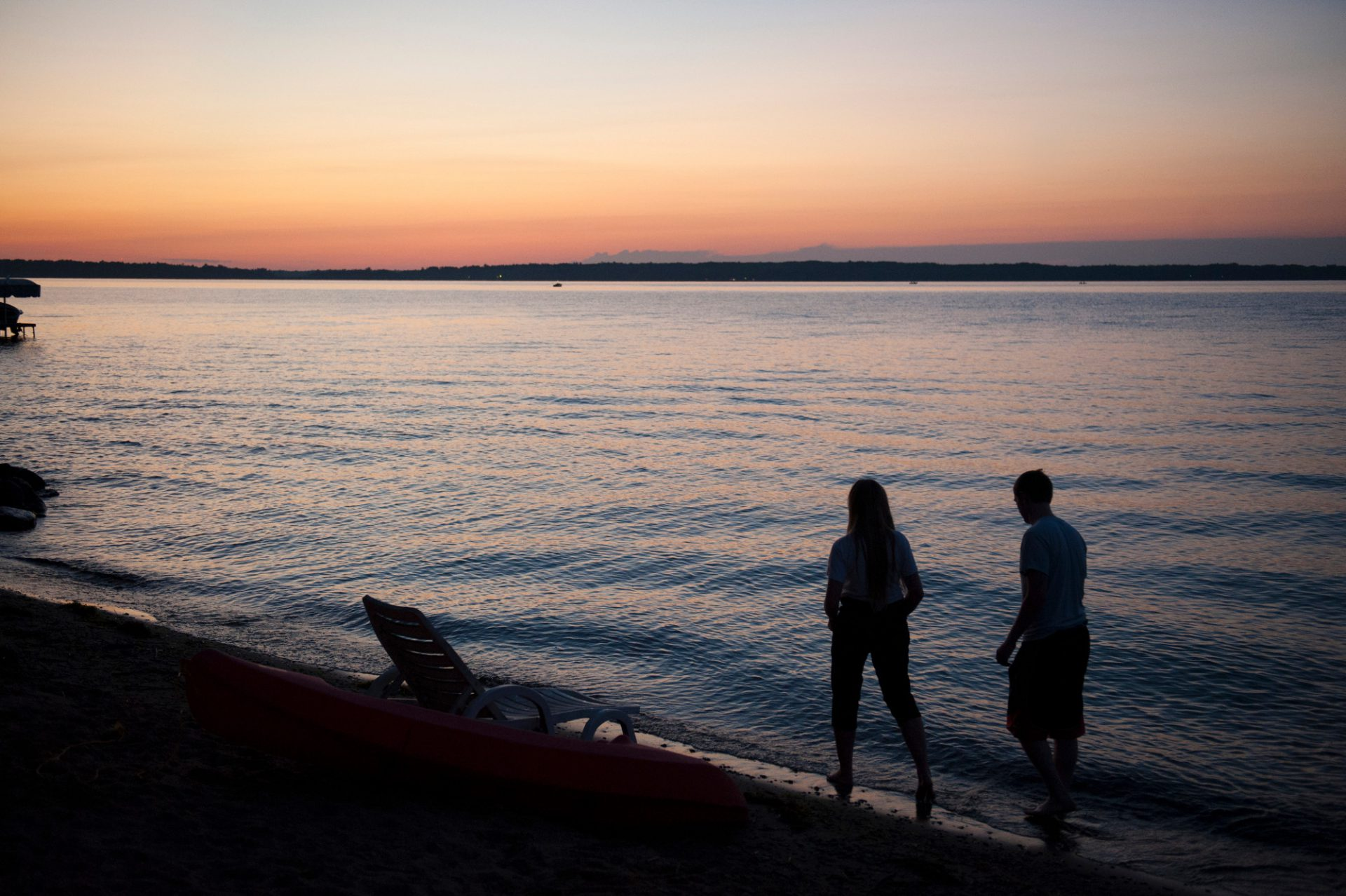 Photo: A brother and sister walk along Leech Lake near Walker, MN.