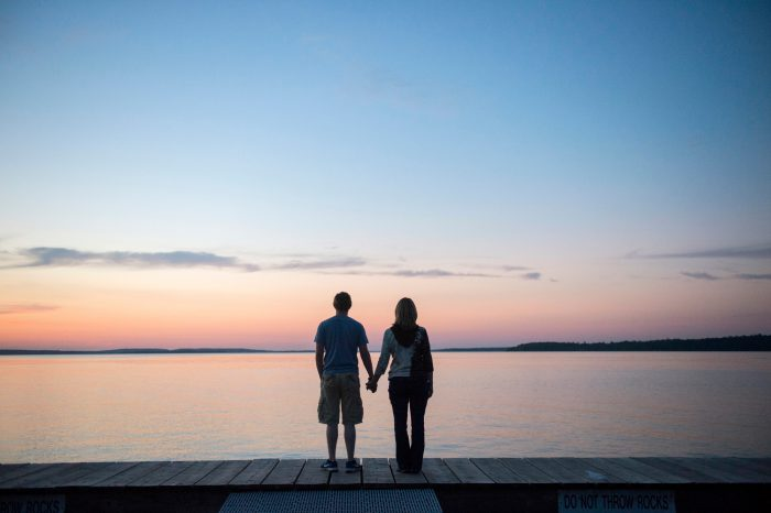 Photo: A woman and her son watch the sun set at Leech Lake, Minnesota.
