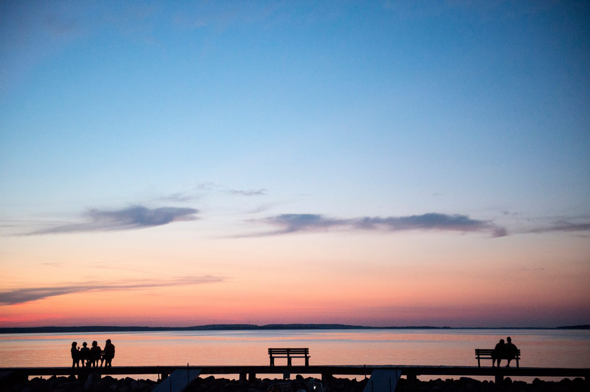 Photo: People watch the sun set at Leech Lake, Minnesota.