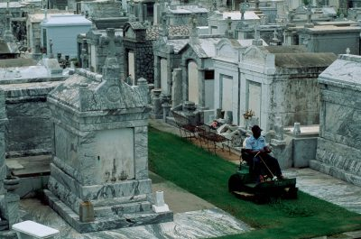 Photo: Mowing the grass at New Orleans' Greenwood Cemetery.