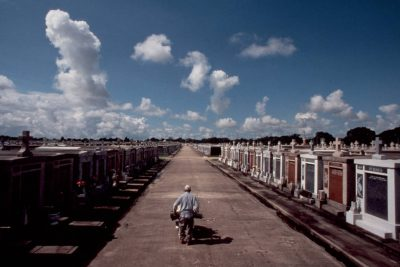 Photo: Tomb painter Charles Simma walks with his wheelbarrow amid the raised tombs of Greenwood Cemetary in New Orleans, Louisiana.