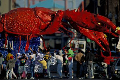 """Photo: Mr. Mudbug, """"the world's largest crawfish"""" is led through downtown New Orleans, LA during the Krewe of Ponchartrain Parade."""