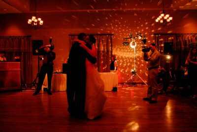 Photo: A bride and groom dance at their wedding reception.