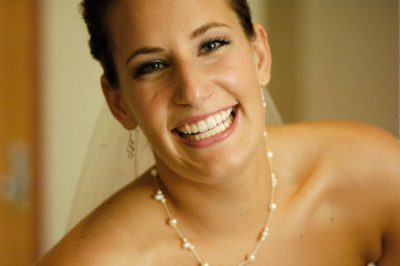 Photo: A bride smiles on her wedding day.