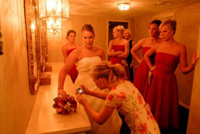Photo: A bride and her bridesmaids freshen up after the wedding.