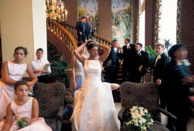 Photo: A woman makes a funny face at a wedding reception.