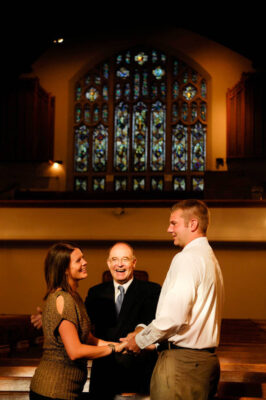 Photo: A couple consults with a pastor before their wedding at Westminster Presbyterian Church in Lincoln, Nebraska.