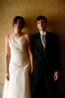 Photo: A couple poses for a portrait on the day of their wedding.