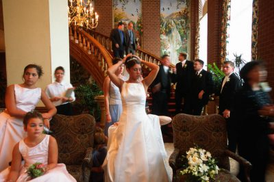 Photo: A wedding party waits to be posed for pictures.