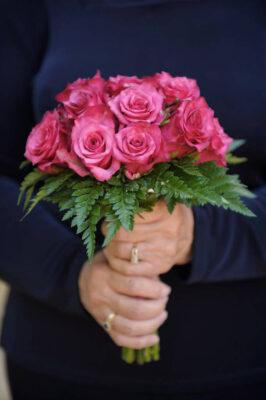 Photo: A woman grips her bouquet at a Nebraska wedding.