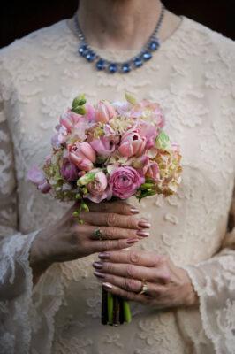 Photo: A bride grips her bouquet at a Nebraska wedding.