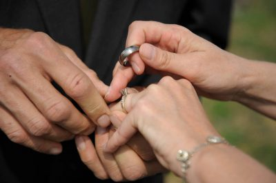Photo: A couple exchanges rings at a Nebraska wedding.