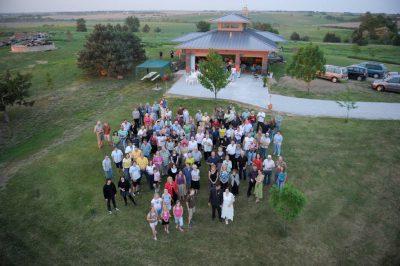 Photo: A brother and sister look at photos at a Nebraska wedding reception.