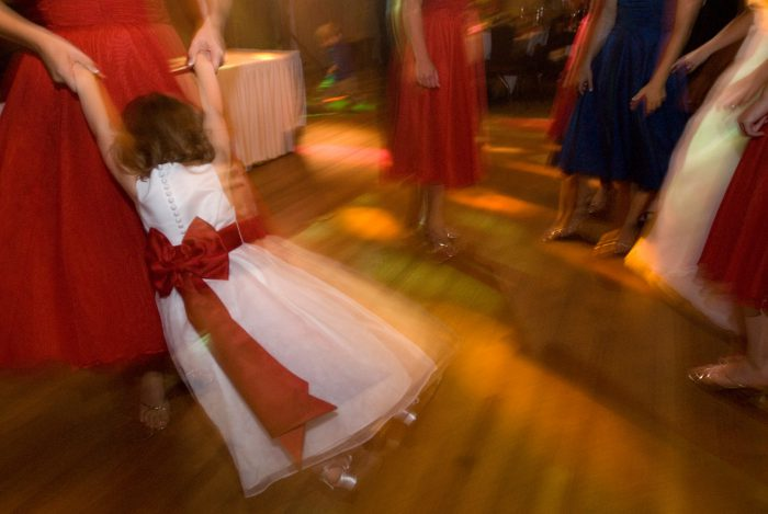 Photo: A flower girl dances with the wedding party.