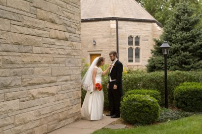Photo: A bride and groom stand outside a Nebraska church on their wedding day.
