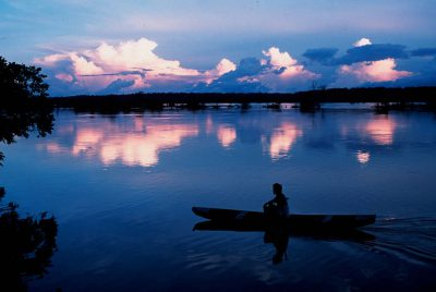 Photo: Native in a small canoe on the Capim River in Brazil, a tributary of the Amazon.