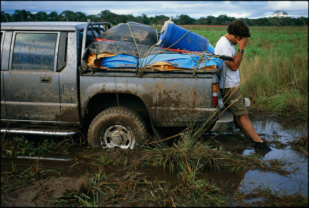 Photo: A man curses the deep mud that has taken hold of his truck in Brazil's Pantanal region.