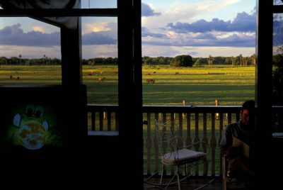Photo: Old meets new on the balcony of the historic main house at Rio Negro Fazenda Ranch in Brazil.