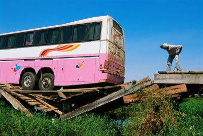 Photo: A bus overloads a fragile bridge on the Transpantaniera highway in Brazil.