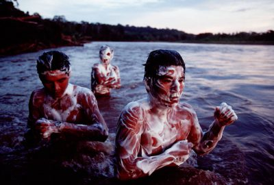 Photo: Natives bathe in the Tuichi river, a tributary of the Amazon, in Madidi National Park, Bolivia.