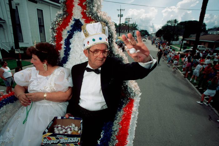 Photo: A former king and queen of the Morgan City LA Shrimp Festival (part of the Blessing of the Fleet), toss candy to the crowd.