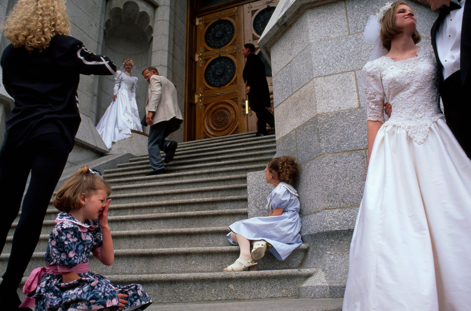 Photo: Newlyweds standing together at the Salt Lake temple in Salt Lake City, Utah.