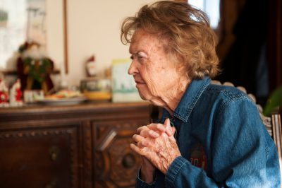 Photo: An elderly woman prepares to receive the Eucharist, a Catholic sacrament, in her home in Lincoln, Nebraska.