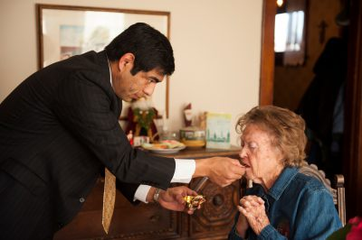 Photo: An elderly woman receives the Eucharist, a Catholic sacrament, in her home in Lincoln, Nebraska.