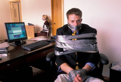 Photo: Brian Lehman and Jamie Neuhaus, taped up in the office for a stock shoot.