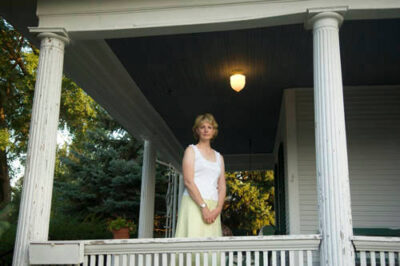 Photo: A woman poses gracefully on a back porch in Lincoln, Nebraska.