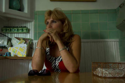 Photo: A woman relaxes in her kitchen.