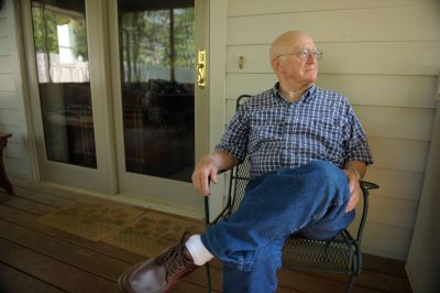 Photo: A senior man relaxes on his porch.