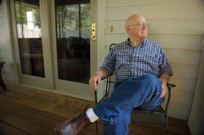 Photo: A senior man relaxes on his porch.