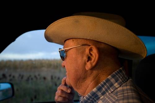 Photo: A senior man goes for a ride in a pickup in Nebraska.