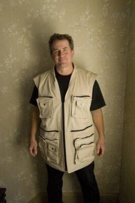Photo: Joel Sartore with his custom made photo vest.