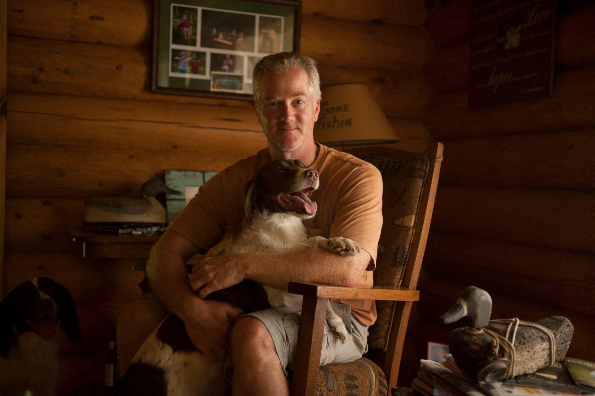 Photo: A man and his English springer spaniel.