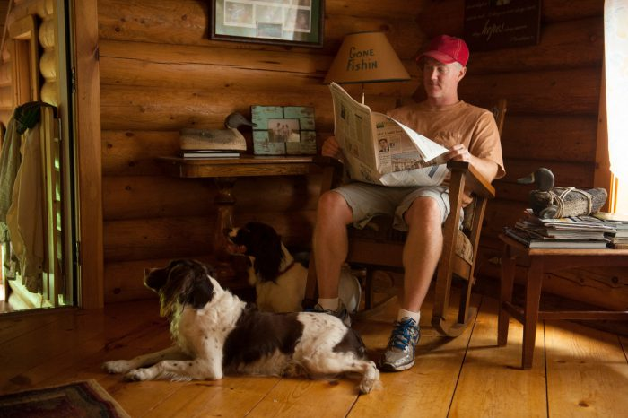 Photo: A man with his English springer spaniels at his home near the town of Cross Lake, MN.