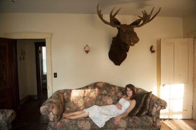 Photo: A teenage girl in a farm house near Dunbar, NE.
