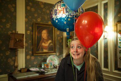 Photo: A teenage girl and birthday balloons, Lincoln, Nebraska.