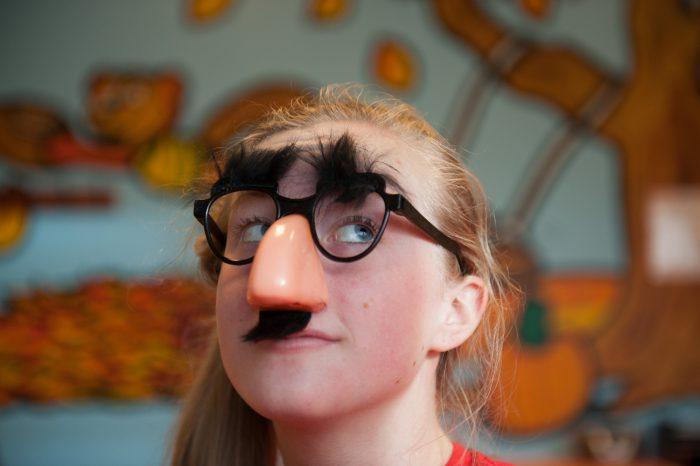 Photo: A teenage girl wears goofy glasses, Lincoln, Nebraska.