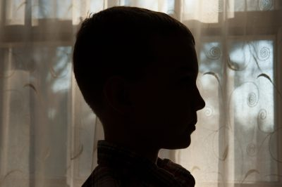 Photo: A silhouette of a young boy, Lincoln, Nebraska.