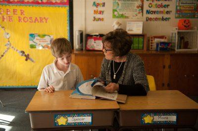 Photo: A young boy, age 9, with his 3rd grade teacher, Lincoln, Nebraska.