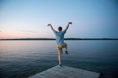 Photo: A young man posing on a pier at Leech Lake, Minnesota.