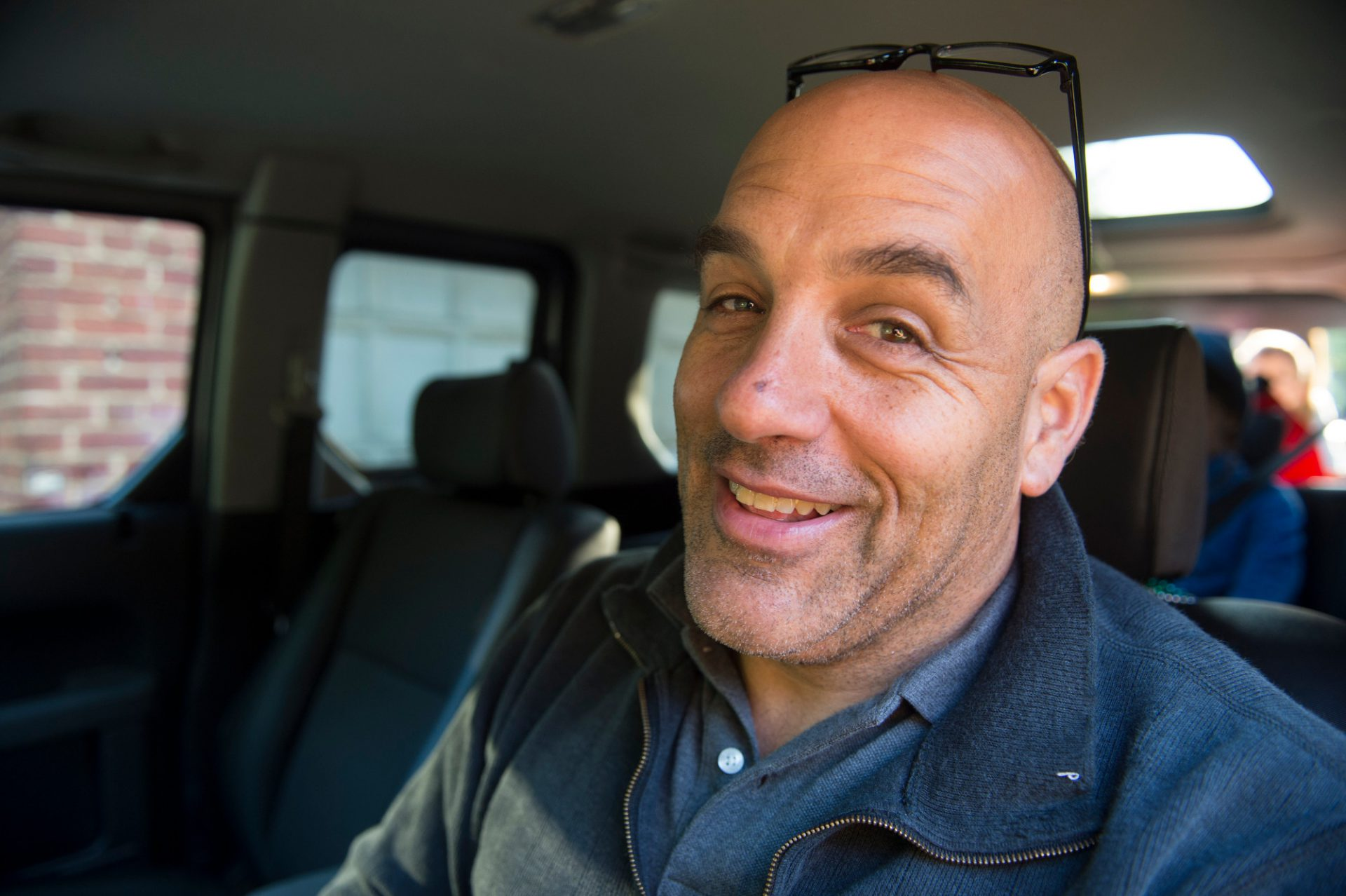 Photo: A man smiles in his vehicle.