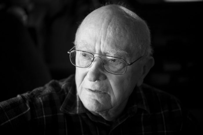 Photo: A portrait of an elderly man in his home.