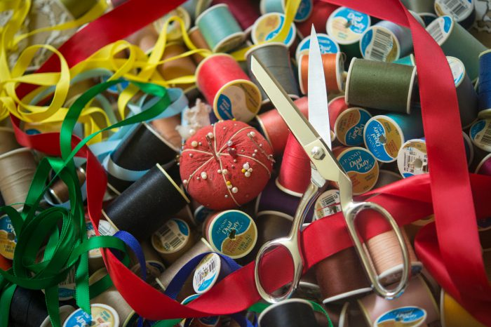 Photo: Sewing supplies including thread and scissors.