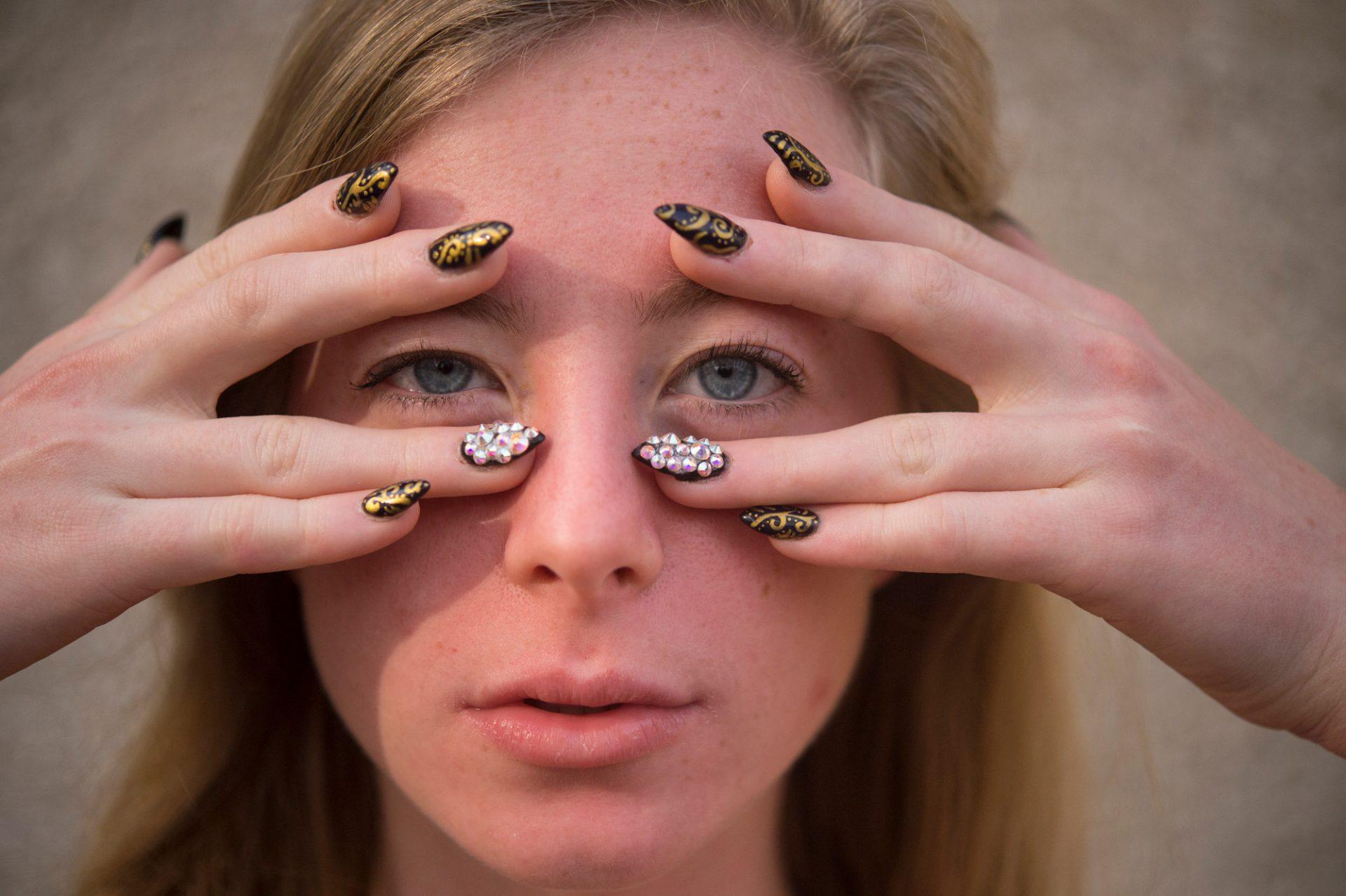 Photo: The fingernails of a teenage girl.