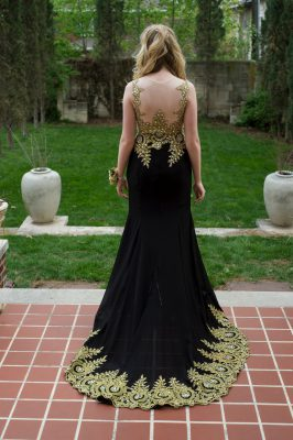 Photo: A teenage girl poses for a portrait before her senior prom.